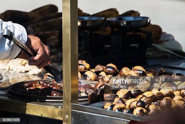 A street stall selling roasted sweet chestnuts, Istanbul, Turkey.