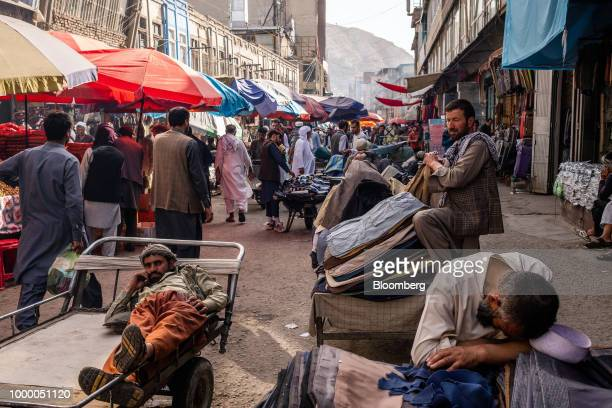 Street stall vendors wait for customers at the Mandai Bazaar in Central Kabul Afghanistan on Thursday July 12 2018 US President Donald last year said...