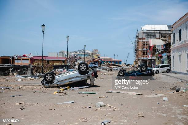 A street stands devastated September 22 2017 in Roseau capital of the Caribbean island of Dominica four days after the passage of Hurricane Maria...