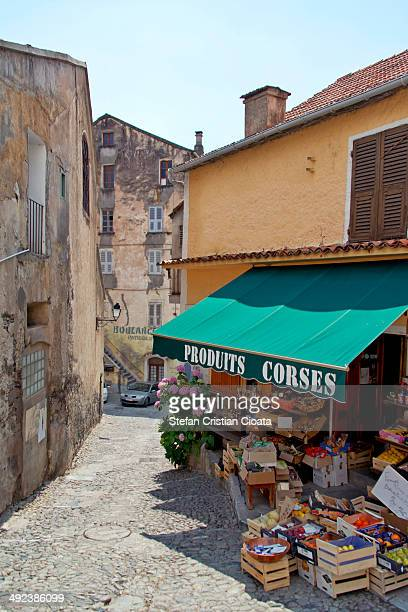 Street store with fresh fruits and vegetables in Corte, Corsica.