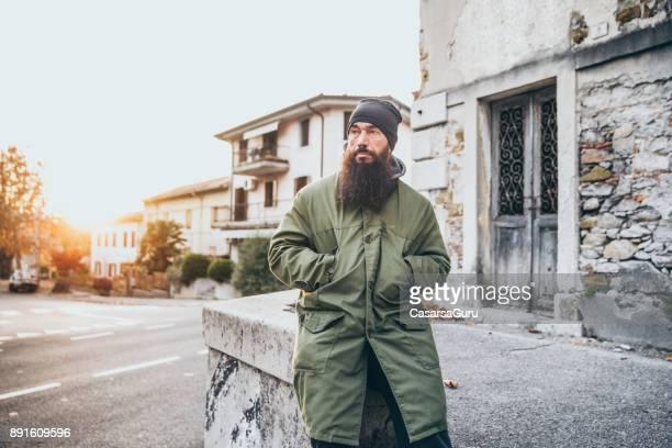Street Style Adult Man Sitting on City Street