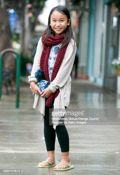 Street Style Alyssa Cuarenta wears a homemade knit scarf a Charlotte Russe jacket she borrowed from her sister along with her Justice flipflops in...