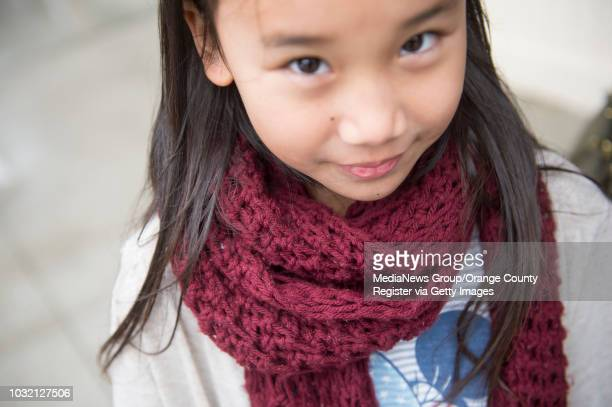 Street Style Alyssa Cuarenta wears a homemade knit scarf and a Charlotte Russe jacket she borrowed from her sister in Seal Beach California December...