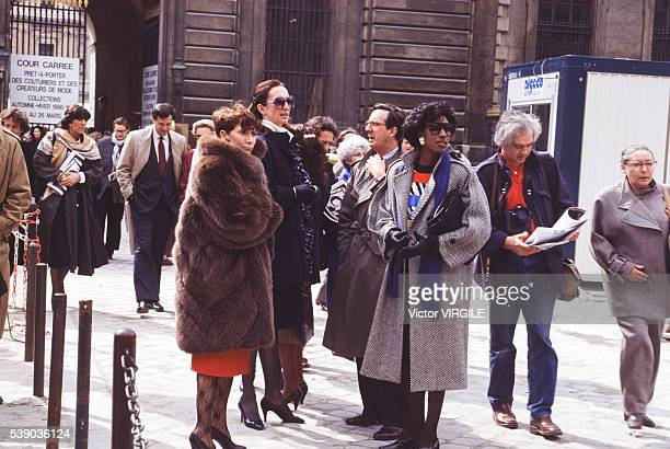 Street style at the Yves Saint Laurent Ready to Wear Fall/Winter 1986-1987 fashion show during the Paris Fashion Week in March, 1986 in Paris, France.