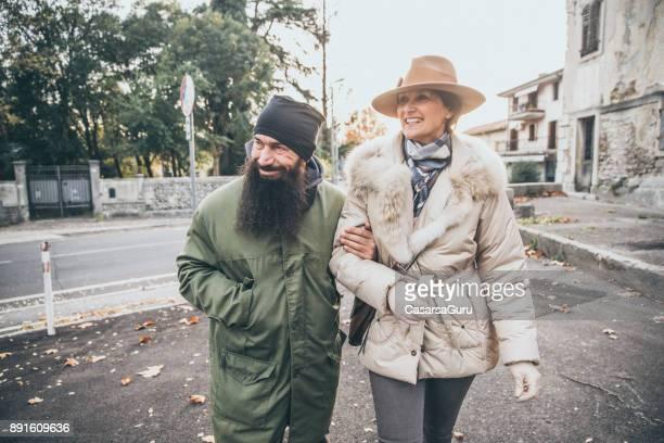 Street Style Mature Man and Classy Mature Woman Walking on City Street