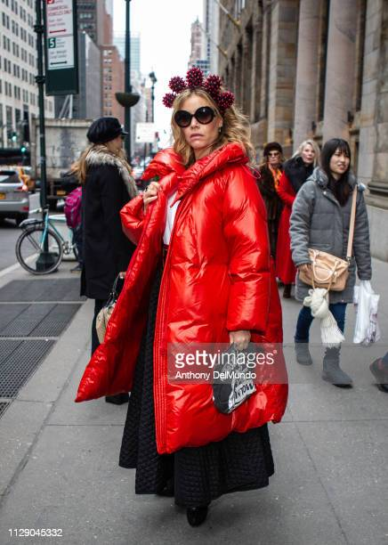 Street style of guest attending Dennis Basso fall 2019 runway show during New York Fashion Week held at Cipriani located at 110 E 42nd Street in New...