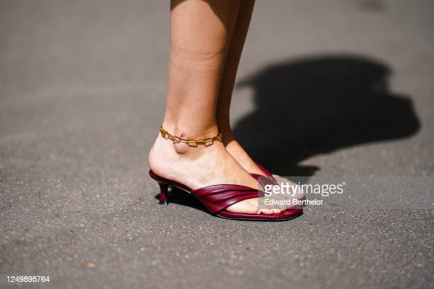 Street style photo session with Gabriella Berdugo wearing Balenciaga burgundy leather sandals a golden ankle bracelet on June 15 2020 in Paris France