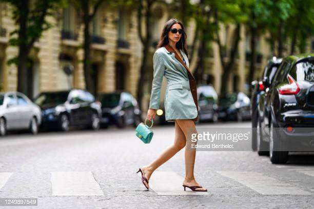 Street style photo session with Gabriella Berdugo wearing Prada sunglasses, a Rolex watch, colorful Shaker Jewel bracelets, a turquoise quilted...