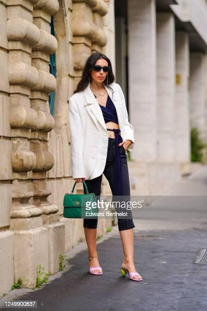 Street style photo session with Gabriella Berdugo wearing Prada sunglasses, Shaker Jewel jewelry, a white oversized blazer jacket from Salisa, a...