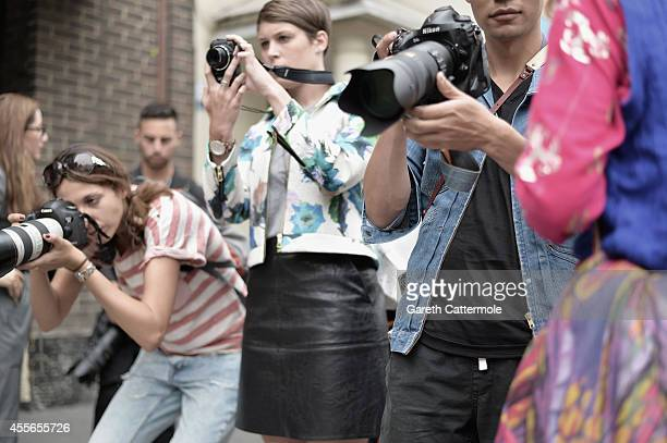 Street style photographers outside the TopShop Show Space during London Fashion Week Spring Summer 2015 on September 16, 2014 in London, England.