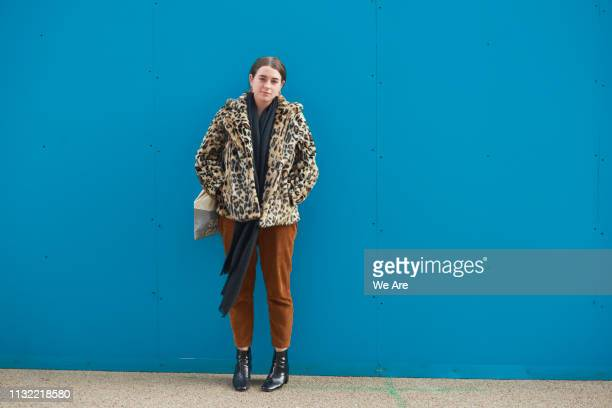 street style portrait of fashionable young woman. - shy stock pictures, royalty-free photos & images