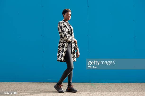 street style portrait of young fashionable woman. - monochrome clothing stock pictures, royalty-free photos & images