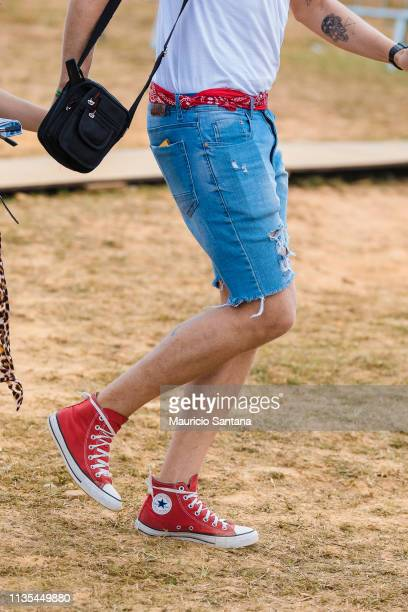 Street style seen on day two of the Lollapalooza Brazil Music Festival at Interlagos Racetrack on April 06, 2019 in Sao Paulo, Brazil.