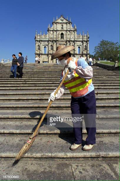 A street sweeper cleans the stairway leading to the facade of St Paul's Cathedral 23 November 1999 in Macau With the handover of Europe's last colony...