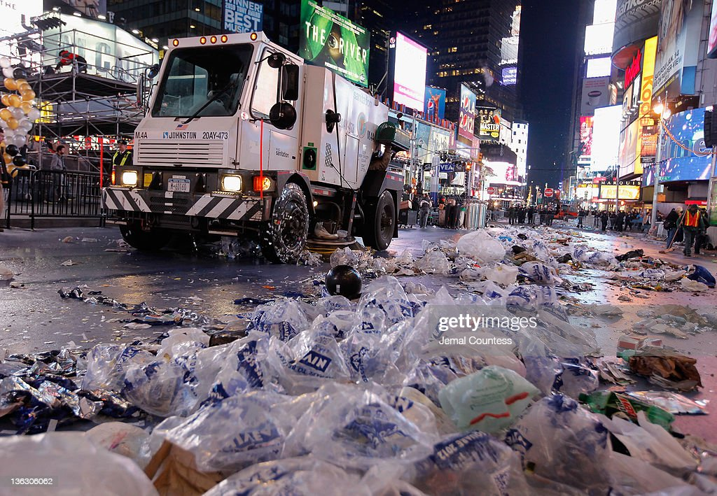 A street sweeper joins dozens of sanitation workers who begin the task of cleaning up after thousands of revelers gathered in New York's Times Square to celebrate the ball drop at the annual New Years Eve celebration on December 31, 2011 in New York City.