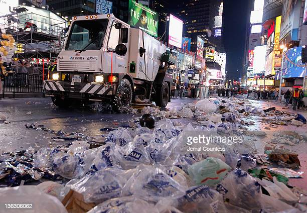 A street sweeper joins dozens of sanitation workers who begin the task of cleaning up after thousands of revelers gathered in New York's Times Square...