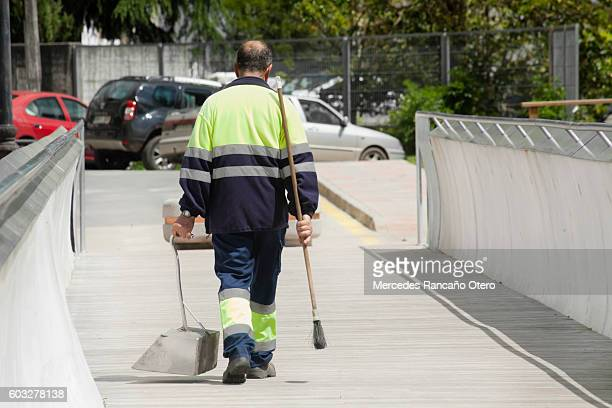 Street sweeper with broom and dustpan.