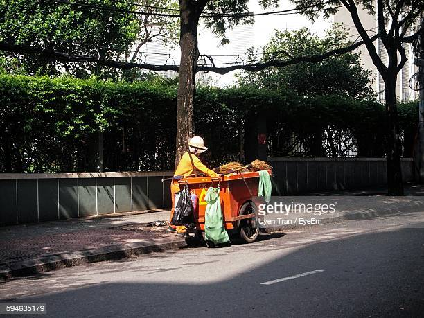 street sweeper working on roadside - street sweeper stock pictures, royalty-free photos & images
