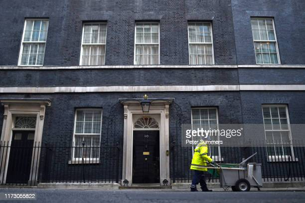 A street sweeper works outside 10 Downing Street on October 2 2019 in London England The UK government prepares to formally submit its finalised...