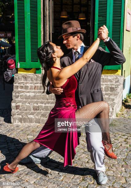 Street tango dancers in front of a bar on the corner of El Caminito, La Boca, Buenos Aires, (birthplace of the tango), Argentina (Model Released)
