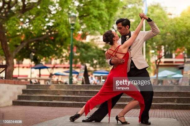 street tango performers in san telmo. - buenos aires stock pictures, royalty-free photos & images