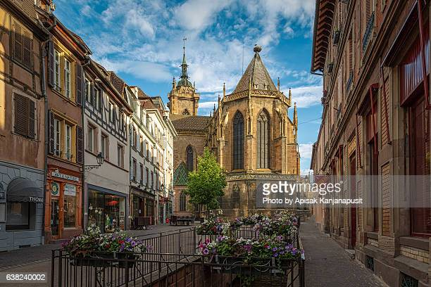 street to st martin's church, colmar - colmar stock photos and pictures