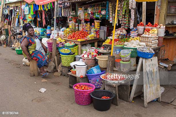A street trader is sitting in front of her market stall where groceries are sold on September 08 2016 in Accra Ghana