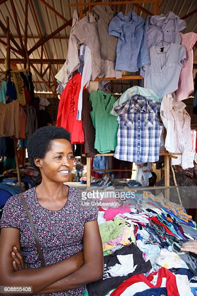 A street trader sells used clothes in a market hall on August 11 2016 in Kigali Rwanda