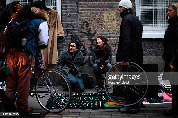 Street traders talk to passers by on Brick Lane on November 21 2010 in London England The East End of London is home to a thriving art community with...