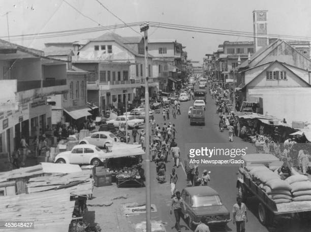 Street traffic and market stalls on Kissy Street Freetown South Africa 1965