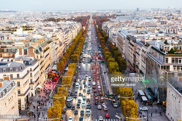 street traffic at avenue des champs-elysees, aerial view - champs elysees quarter stock pictures, royalty-free photos & images
