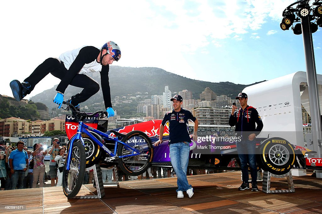 Street trials rider Danny MacAskill performs onboard the Red Bull Energy Station whilst Sebastian Vettel of Germany and Infiniti Red Bull Racing and Daniel Ricciardo of Australia and Infiniti Red Bull Racing look on ahead of the Monaco Formula One Grand Prix at Circuit de Monaco on May 21, 2014 in Monte-Carlo, Monaco. Danny MacAskill is in Monaco ahead of the release of his new film 'Epecuén' on Tuesday 27 May.