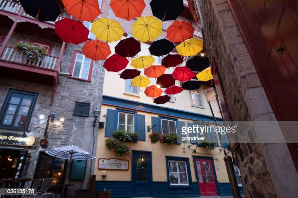 street umbrellas in quebec city - old quebec stock pictures, royalty-free photos & images