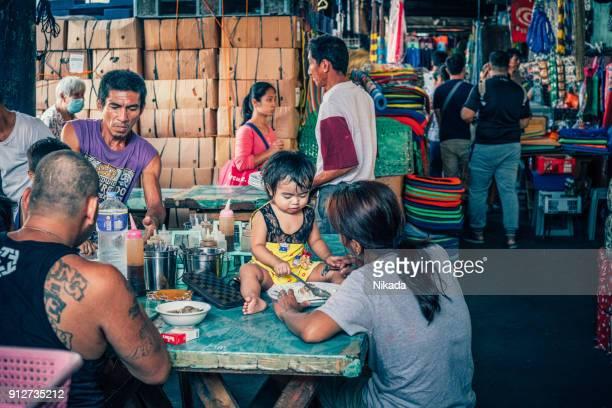Street vendor at market in Manila, Philippines