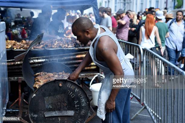 A street vendor cooks jerk chicken on first day of the Notting Hill Carnival in West London United Kingdom on August 27 2017 Nearly one million...