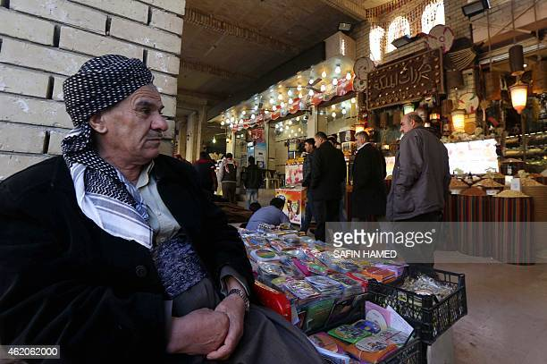 A street vendor displays items on a stall at a market at the bottom of the Arbil Citadel on January 13 2015 in Arbil the capital of the autonomous...