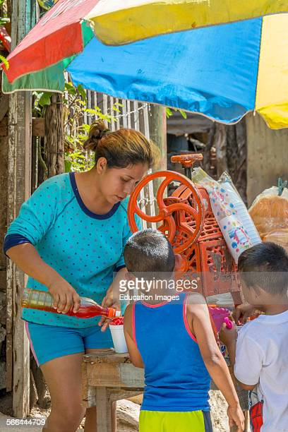 Street vendor for shaved iced fruit drink and snacks in a village in Guatemala