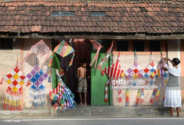 TOPSHOT A street vendor hangs kites for sale in Piliyandala on the outskirts of Colombo on July 29 2019