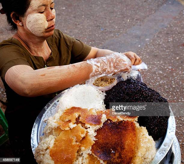 street vendor in downtown yangon - black rice stock pictures, royalty-free photos & images