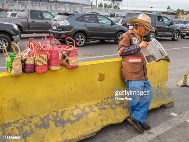 usa/mexico border - san ysidro boundary - immigrants crossing sign stock photos and pictures