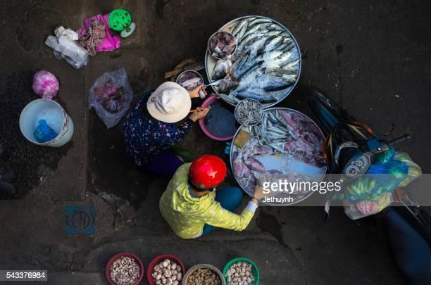 Street Vendor in Ho Chi Minh City, Vietnam selling fresh fish at the market