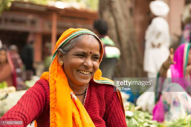 street vendor indian woman smiling - hinduism stock pictures, royalty-free photos & images