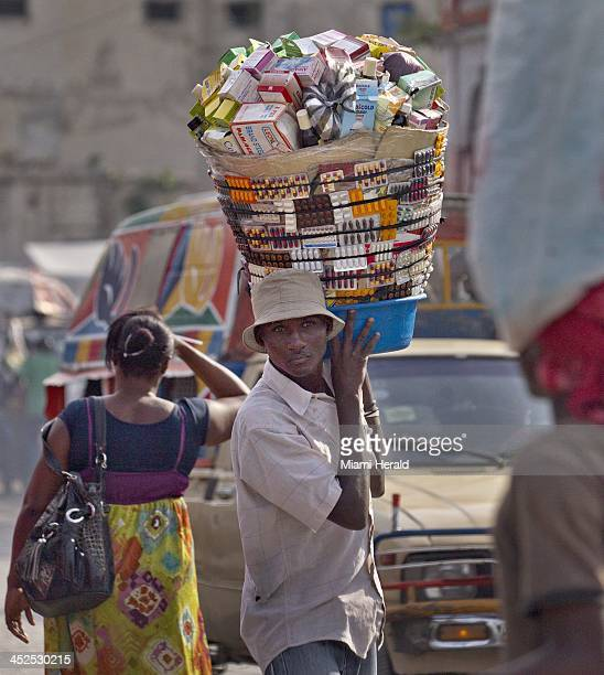 Street vendor Laurent Delva sells Cytotek on the streets near Haiti's General Hospital for the equivalent of $250 US The pill is commonly used by...