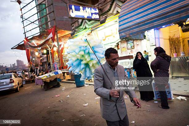 A street vendor looks for buyers Feburary 20 2011 in Mahalla elKubra 125 miles north of Cairo Egypt Mahalla elKubra is home to Egypt's largest...
