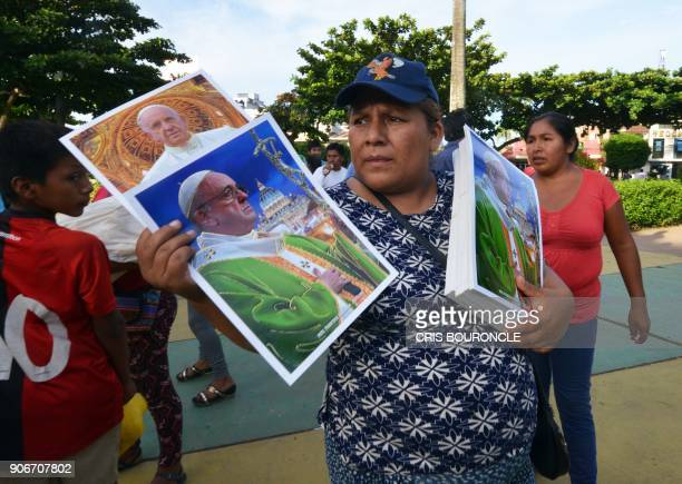 A street vendor offers posters of Pope Francis at the main plaza in the Amazonian town of Puerto Maldonado Peru on January 18 2018 Pope Francis...