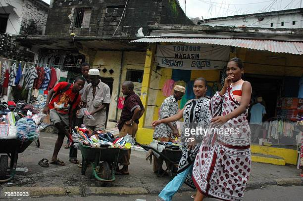 A street vendor offers sandals for sale in a street of the Comoran island of Anjouan on February 12 2008 The African Union extended on February 19...