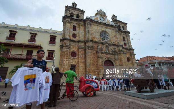 A street vendor offers Tshirts with the image of Pope Francis in front of the church of Saint Peter Claver patron saint of slaves where the pontiff...