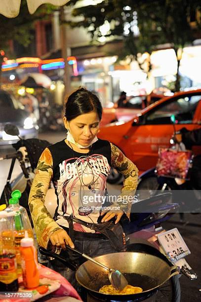 Street Vendor Preparing Food in Mobile Kitchen on Sukhumvit Road