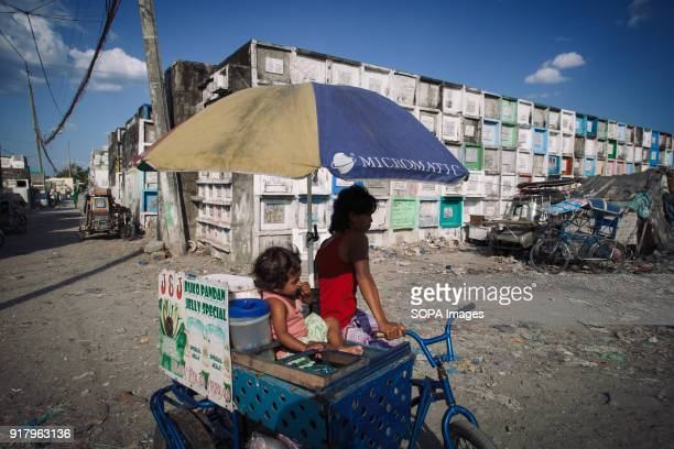 CEMETERY MANILA PHILIPPINES A street vendor seen selling snakes at the cemetery slum In the center of Pasay District of Metro Manila is a cemetery...