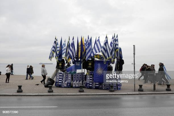 A street vendor sell Greek and Macedonia flags at the seafront promenade of Thessaloniki during a protest rally against the developments on the issue...